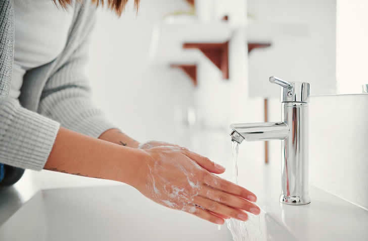 GettyImages-Woman-washing-hands-Jay-Yuno.jpg